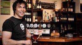 Paul Croucher serving beer